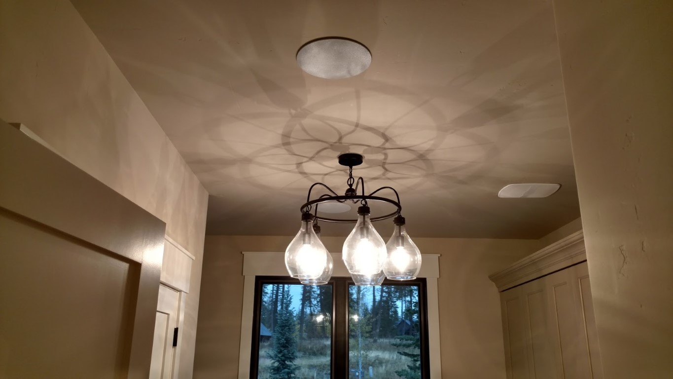 Seamless ceiling speakers and integrated lighting