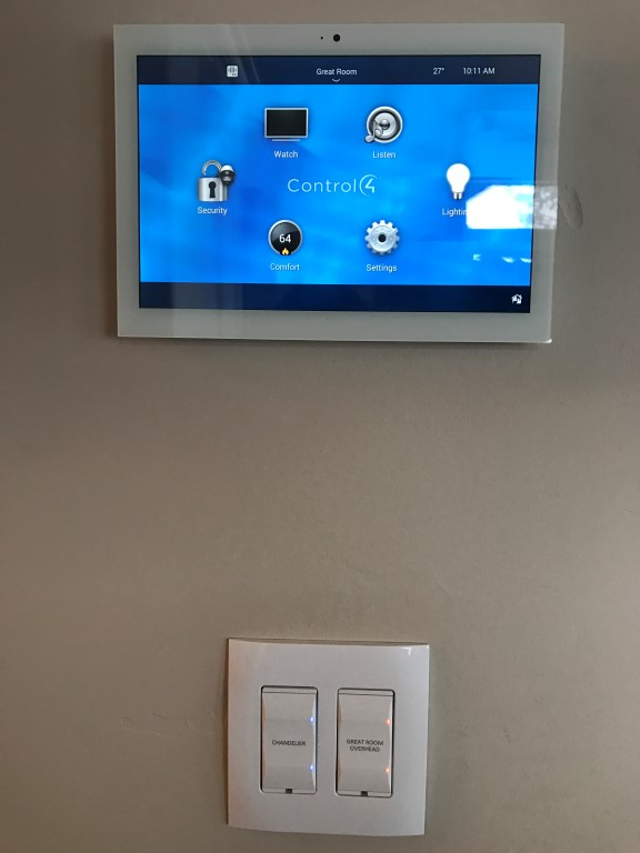 The touch panel here is a control center and can control audio, video, lighting ,thermostats, garage doors the security system and intercom for any room in the house, making it easy to make changes or turn everything off before bed.