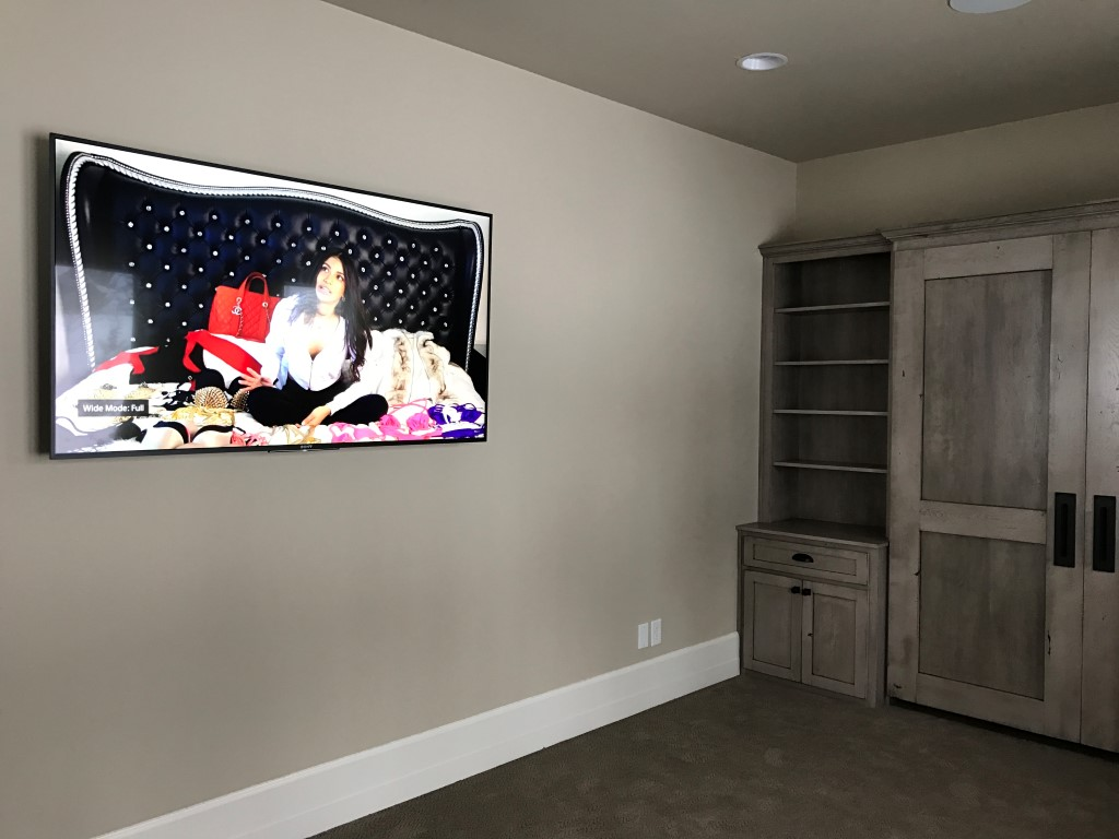 This sitting area again with the panel only and nothing else taking up an inch of floor or wall space. Ceiling speakers fill the room with sound for video or audio.